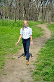 Young girl goes on a footpath. Young girl in white blouse goes on a footpath in a park Stock Photo