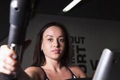 A young girl goes in for sports in the gym . Stock Images