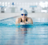 Young girl in goggles swimming breaststroke stroke style Royalty Free Stock Photography