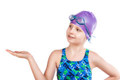 Young girl in goggles and swimming cap. Stock Images