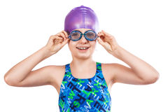 Young girl in goggles and swimming cap. Portrait of a young girl in goggles and swimming cap. happy girl royalty free stock photo