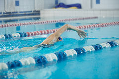 Young girl in goggles swimming front crawl stroke style Stock Photo