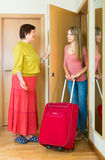 Young girl going to rest. And saying goodbye to her mother at the door Royalty Free Stock Photos