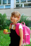 Young girl going to school Stock Images