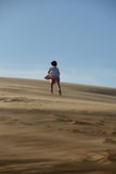 Young girl going uphill in desert Royalty Free Stock Photo