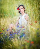 Young girl on golden wheat field Royalty Free Stock Photography