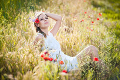 Young girl on golden wheat field Stock Photography
