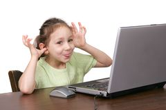 Young girl goofing on computer Stock Photo