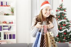 Young girl got some present bags at christmas Royalty Free Stock Photos