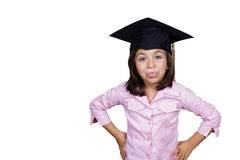 Young girl in graduation cap grimacing Royalty Free Stock Image