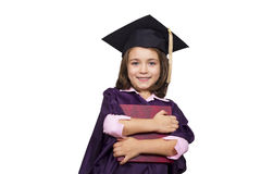 Young girl in graduation dress Stock Images