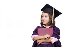 Young girl in graduation dress Royalty Free Stock Photo