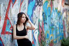 Young girl on graffiti background stock images