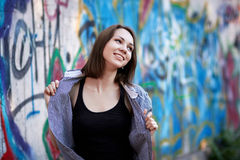 Young girl on graffiti background royalty free stock image