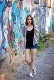 Young girl on graffiti background royalty free stock photo