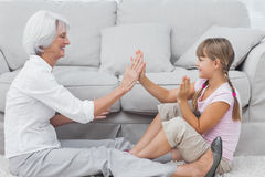 Young girl and grandmother playing together Stock Photography