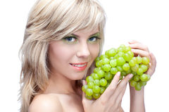 Young girl with grape Stock Photo