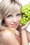 Young girl with grape Stock Photos