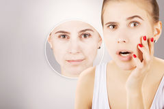 Young girl with grapnics of her old skin, grey background Royalty Free Stock Image