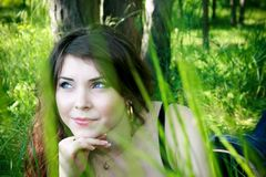 Young girl in the grass Stock Photos
