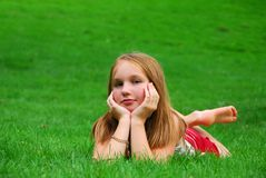 Young girl grass royalty free stock photography