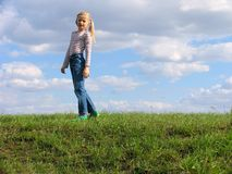 Young girl on grass royalty free stock image