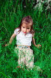 Young girl on the grass royalty free stock images