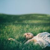 Young girl on the grass. In the photo young girl on the grass Stock Photos