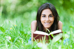 Young girl grass reading book Royalty Free Stock Photography