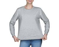 Young girl in gray sweatshirt, hoodies. white background Royalty Free Stock Photos