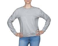 Young girl in gray sweatshirt, hoodies. white background Stock Image
