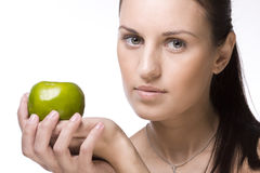 Young girl with green apple Royalty Free Stock Photo