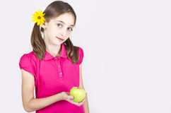 Young girl with green apple over grey Stock Photo