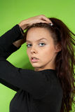 Young girl on a green background Royalty Free Stock Image