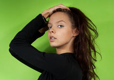 Young girl on a green background Stock Image
