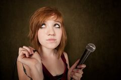 Young girl on a green background with microphone Stock Photos