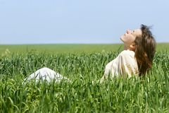 Young girl in green grass. Young girl relaxing in green grass Royalty Free Stock Images