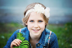 Young Girl with Green Leaf Outdoors. Spring Stock Photography