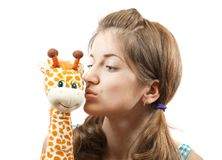 Young girl in green with soft toy Stock Photos