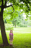 Young girl in the greenery park Royalty Free Stock Photography