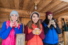 Young Girl Group On Terrace Holding Cup Hot Coffee Tea Wooden Country House Winter Resort. Cottage Vacation Royalty Free Stock Photos