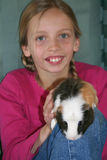 Young girl with guinea pig. Portrait of smiling young girl with guinea pig pet on knee Stock Photos