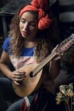 Young girl with a guitar. Stock Image
