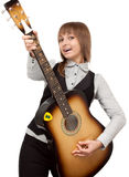 Young girl with guitar sings Stock Images