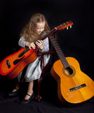 Young girl with guitars Royalty Free Stock Photo