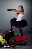 Young girl with a gun Stock Photography