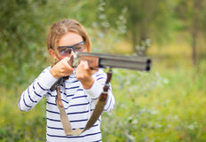 A young girl with a gun for trap shooting stock photo