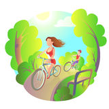 Young girl and the guy on a bike ride in the park. Activity outdoor sports. Cyclists travel. Young girl and the guy on a bike ride in the park. Activity outdoor Stock Photo