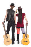 Young girl and guy with the guitars. Young girl and the guy with the guitars, rear view stock photos