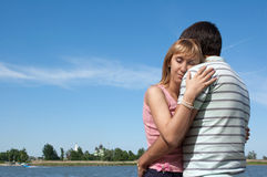 Young girl and the guy on the river bank Royalty Free Stock Photo